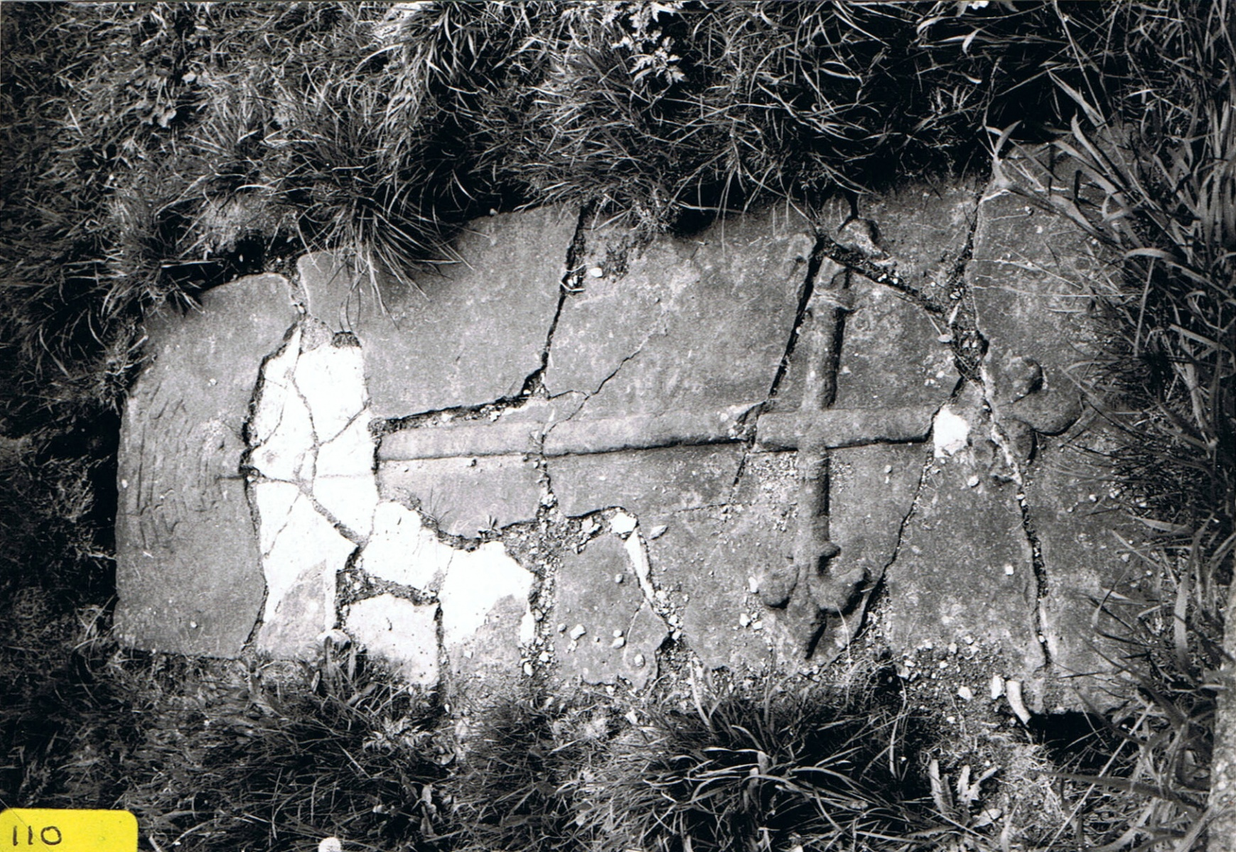 12th/13th centuries. Tomb slab near church porch. Originally uncovered in 1851 while digging foundations for extension to church.