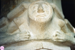 January 1987 Second capital from the easternmost pillar. Head with linked arms.