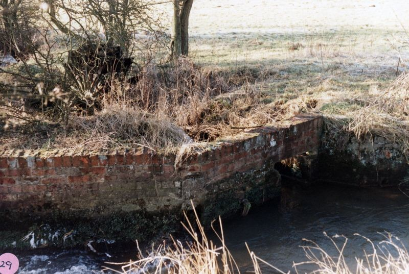1986 Old water wheel near site of cottages in the Fields.