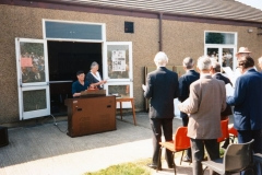 7 May V.E. Day Parade. Playing Fields. Derek and Deanne Gardner behind the organ. Robert Pim standing far left. Stan Wood closest to camera. Robin Fleming in hat.