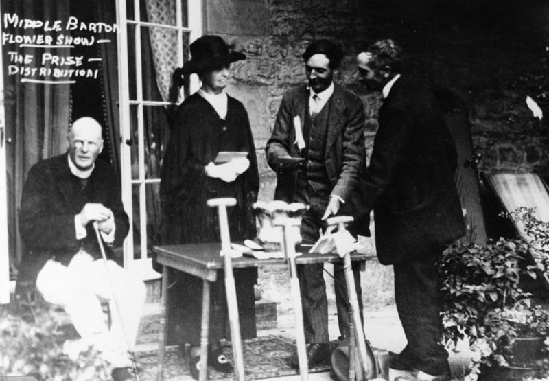 Middle Barton Flower Show. The prize distribution. L to R: Canon Carroll, Emma Stapleton, George Stockford, Charles Marsh.