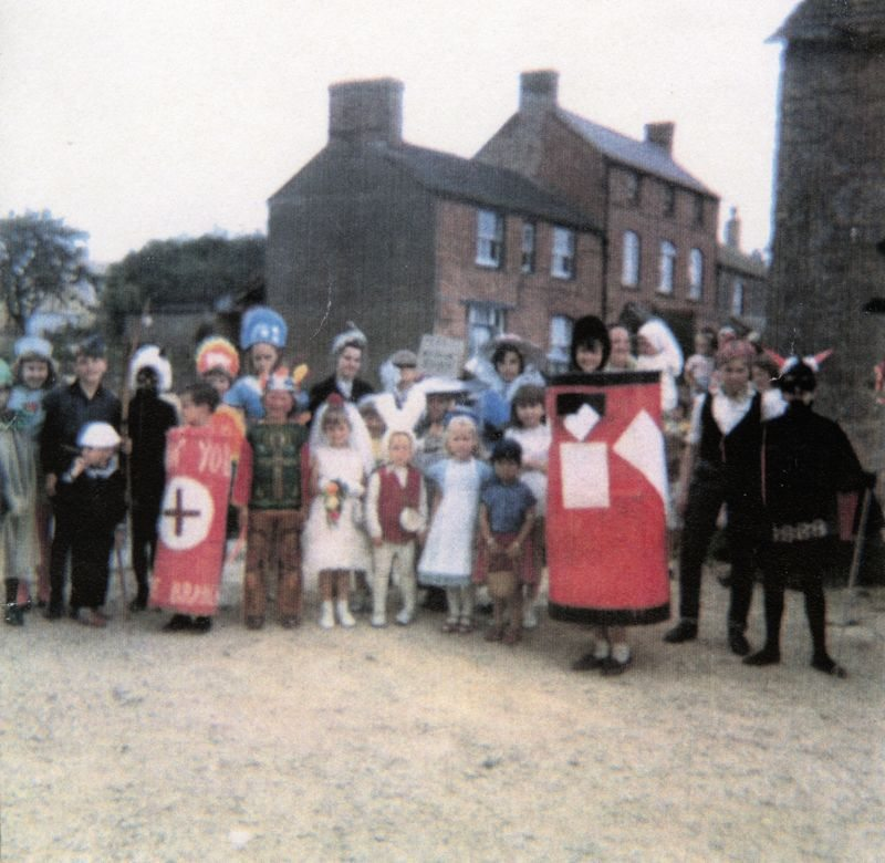1960s Preparing for the Fancy Dress competition at the Barton Abbey fete. The children were taken from the Fox on a trailer pulled by a tractor.