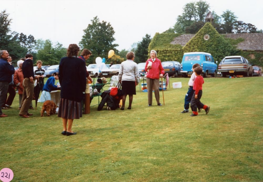 June 1987 Steeple Barton Church fete at Barton Abbey. Mrs. Joan Fleming (in red).