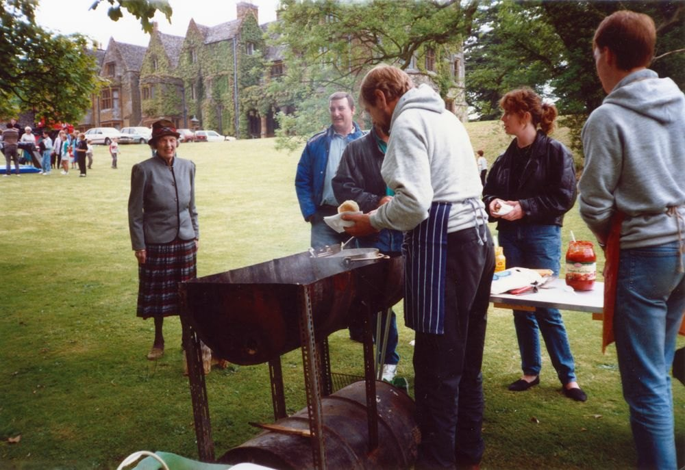 June 1987 Steeple Barton Church fete at Barton Abbey. Mrs. Joan Fleming, Eddie Harrison, Bill Edbury (Venture Scout Leader), Jo Yates and Tim Yates (Venture Scouts), manning the beefburger stall.