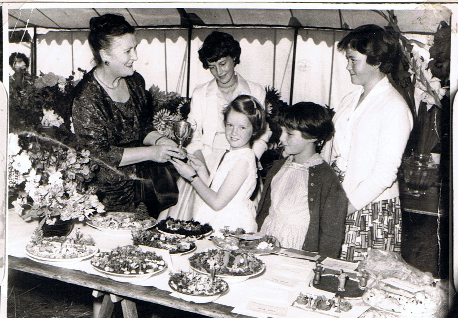 1961 Flower Show, Rectory, Middle Barton. Flower Shows have since been revived by the Bartons and District Horticultural Society and are held at the Sports and Social Club.