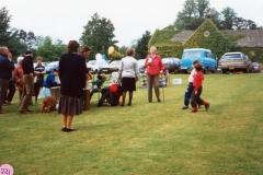 June 1987 Steeple Barton Church fete at Barton Abbey. Mrs. Joan Fleming (in red).