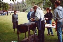 June 1987 Steeple Barton Church fete at Barton Abbey. Mrs. Joan Fleming, Eddie Harrison, Bill Edbury (Venture Scout Leader), Jo Yates and Tim Yates (Venture Scouts), manning the beefburger stall.