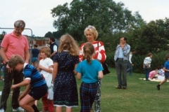 July 1987 Middle Barton School Fete - Matthew Houston on left, children William, Tricia and Angela. Joan Alexander in the centre. + ? John Hanks on the right.