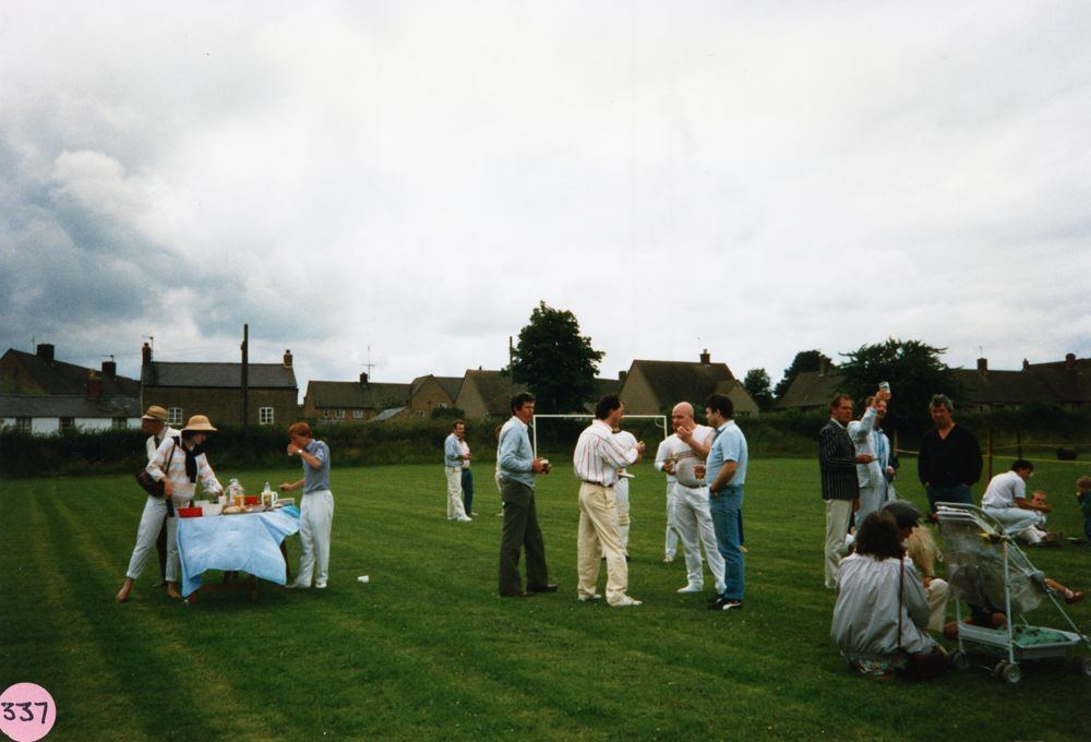 July 9 1988 Playing fields. Cricket match interval. Centre group - Pete Watts, Tim and John Fowler. Edward Fowler (no relation).