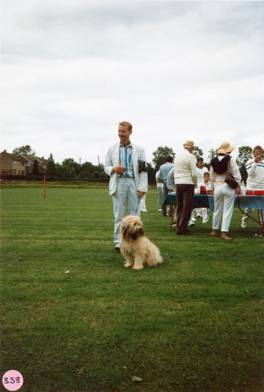July 9 1988 Playing fields. Cricket match interval. David Langston and dog.