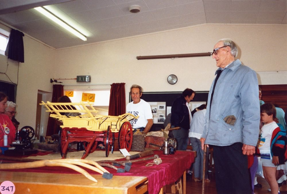 July 9 1988 Middle Barton Primary School Exhibition. Ken Castle with his model wagon and other models on display.