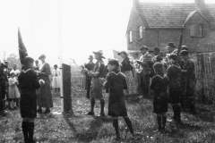 1953 Coronation. Scouts on the bank left of the first council house, now the entrance to Fleming Drive.