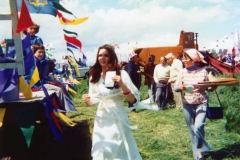 June 7 1977 Floats in the Silver Jubilee procession. Foreground: Jenny Charles, the Jubilee Queen. Right: Chris Jones, the Jubilee Secretary, aka 'Jubilee Jones'.