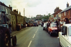 June 7 1977 Silver Jubilee procession - North Street. Lynda Mason, extreme right with dark hair, and Rob Mason (holding Samantha) - then living at Sebastian Cottage, North Street.