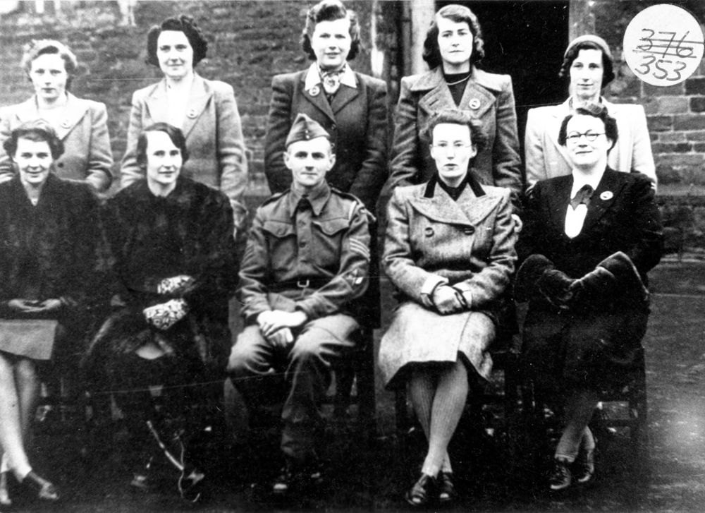 WW II l -> r back row: ?, ?, ?, ?, Marjorie Young. Front row: Moira Moulsdale, Katherine Morris, Frank Henderson, Joan Sullivan and Lydia Cross.