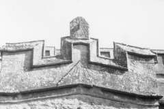 The sun dial on the gable of the 15th century porch and the smaller sundial above it which has been reset.