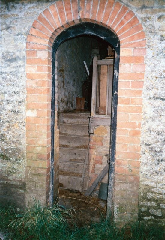 December 1985 Door in building south side of drive of Manor Farm. Door date 1775.