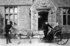 c. 1900 Reverend Jenner and Mrs. Marshall. Richard Buswell by the donkey's head.
